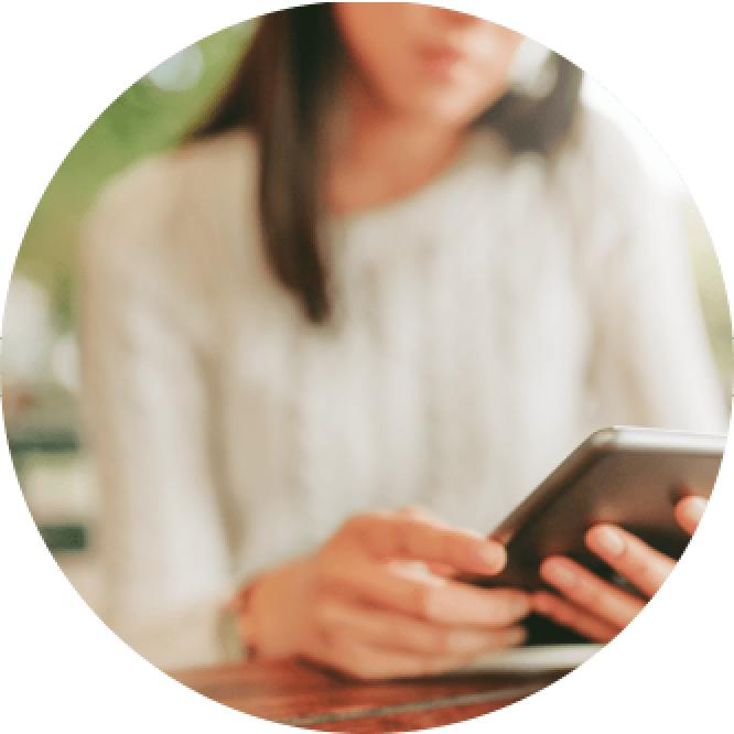 Woman using her smartphone image